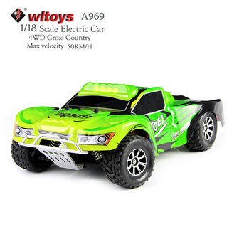 Wltoys A969 RC Auto 4WD Scala 1:18 2.4G Ad Alta Velocità Radio Controlled Car Da Corsa di Telecomando Cross-country auto Mini automotive